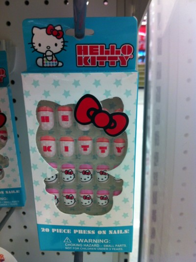 Hello Kitty press on nails that spell Hello Kitty
