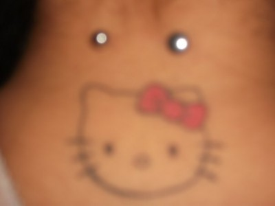 Hello Kitty neck tattoo