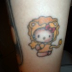 hello kitty lion tattoo