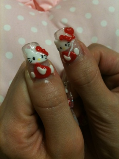 Hello Kitty nails thumbs
