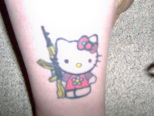 Hello Kitty assault rifle tattoo
