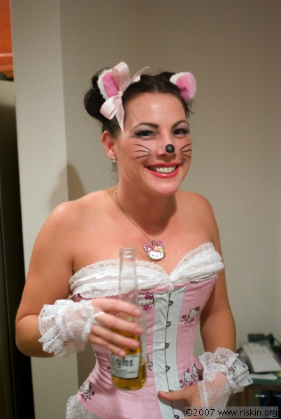 cat in hello kitty costume. Of course, if there was Hello Kitty beer, she would be doing it with that,