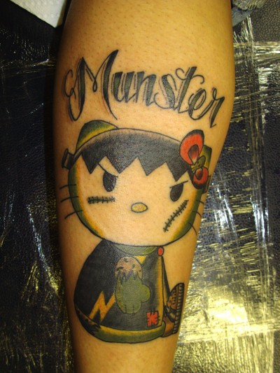 hello kitty munster tattoo