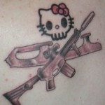 hello kitty skull gun tattoo