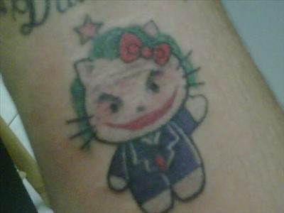 hello kitty joker tattoo