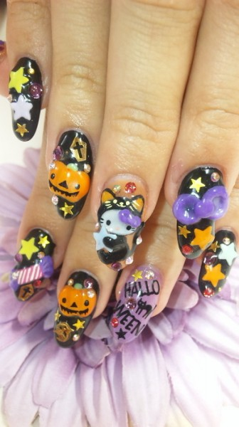 Hello Kitty black cat and pumpkin Halloween finger nail art