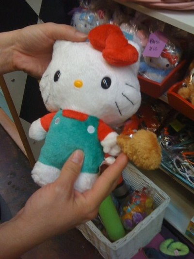 Hello Kitty holding chicken